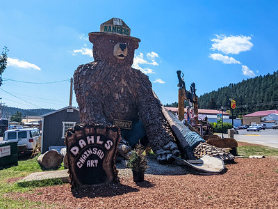 30-ft tall Smokey Bear wood sculpture at Dahl's Chainsaw Art, Hill City, South Dakota. I met a nice couple, Dan and Wendy, who are running the shop. They are living in a Dodge van and putting money in the bank so they can buy a school bus and convert it.
