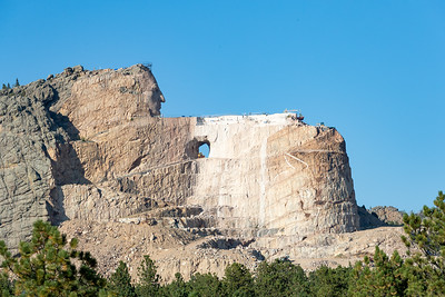 The Crazy Horse Memorial monument has been in progress since 1948 and is far from completion. If completed as designed, it will become the world's second tallest statue, after the Statue of Unity in India. The sculpture's final dimensions are planned to be 641 feet (195 m) long and 563 feet (172 m) high. The arm of Crazy Horse will be 263 feet (80 m) long and the head 87 feet (27 m) high; by comparison, the heads of the four U.S. Presidents at Mount Rushmore are each 60 feet (18 m) high. Crazy Horse, South Dakota