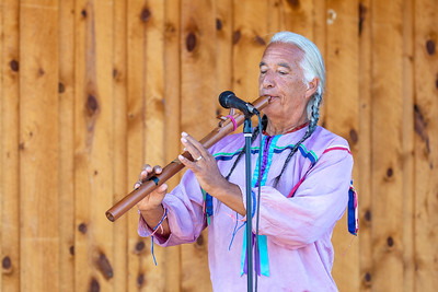 """Kevin Locke (Hunkpapa Lakota) performing at Crazy Horse Memorial. Tokeya Inajin is his Lakota name, meaning """"The First to Arise."""" He is known throughout the world as a visionary Hoop Dancer, preeminent player of the indigenous Northern Plains flute, a traditional storyteller, cultural ambassador, recording artist and educator. Crazy Horse, South Dakota"""