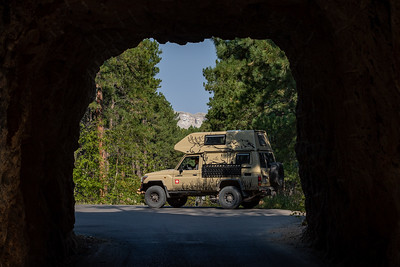 A view of Mount Rushmore through Scovel Johnson Tunnel on US-16A, Iron Mountain Road, Keystone, South Dakota. At the next overlook, I talked to the pleasant Swedish couple who are traveling the US in this imported Desert-Tec.de Toyota Landcruiser.