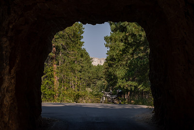 A view of Mount Rushmore through Scovel Johnson Tunnel on US-16A, Iron Mountain Road, Keystone, South Dakota
