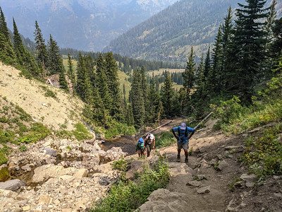 Our Xscapers group reaching our destination on a 6.3-mile hike on the Darby Canyon Wind Cave Trail, Alta, Wyoming