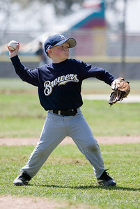 Christopher throwing the ball to 1st base. Brewers vs. Cardinals, 2007 North Side Little League Baseball, Tee Ball Division