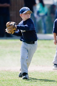 Christopher getting ready to throw the ball to 1st base. Brewers vs. Cardinals, 2007 North Side Little League Baseball, Tee Ball Division