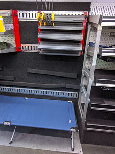 Toolbox storage area and shelving behind passenger's seat