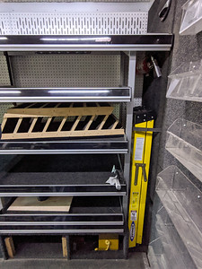 These rear shelves on the passenger's side are being removed to make room for the 20-in wide Snap-on toolbox, which is currently at the front door. I will leave a 15-in gap between the back wall and the toolbox as a place to store my mountain bike.