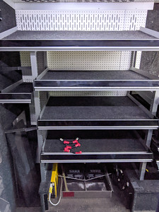 The rear shelves on the driver's side, which are 4.5-ft wide and 25-in deep, are being changed to a 3-ft width to line up with the tool box on the opposite wall. The depth is also being cut down to 22-in to make it easier to get in and out of the back door.
