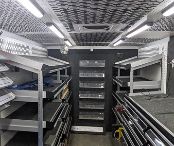 """The back of the step van has shelving on both the passenger and driver sides. I will remove all of this shelving and reconfigure the back 3-ft as a """"garage"""". The next 5-ft toward the front, which includes the boxed-in wheel wells, will be for a double-sized bed across the width of the van."""