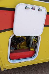 Driver's door storage compartment