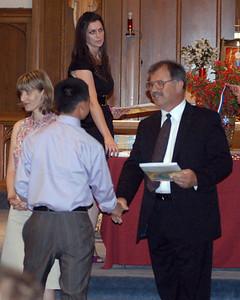 Patrick receiving his diploma