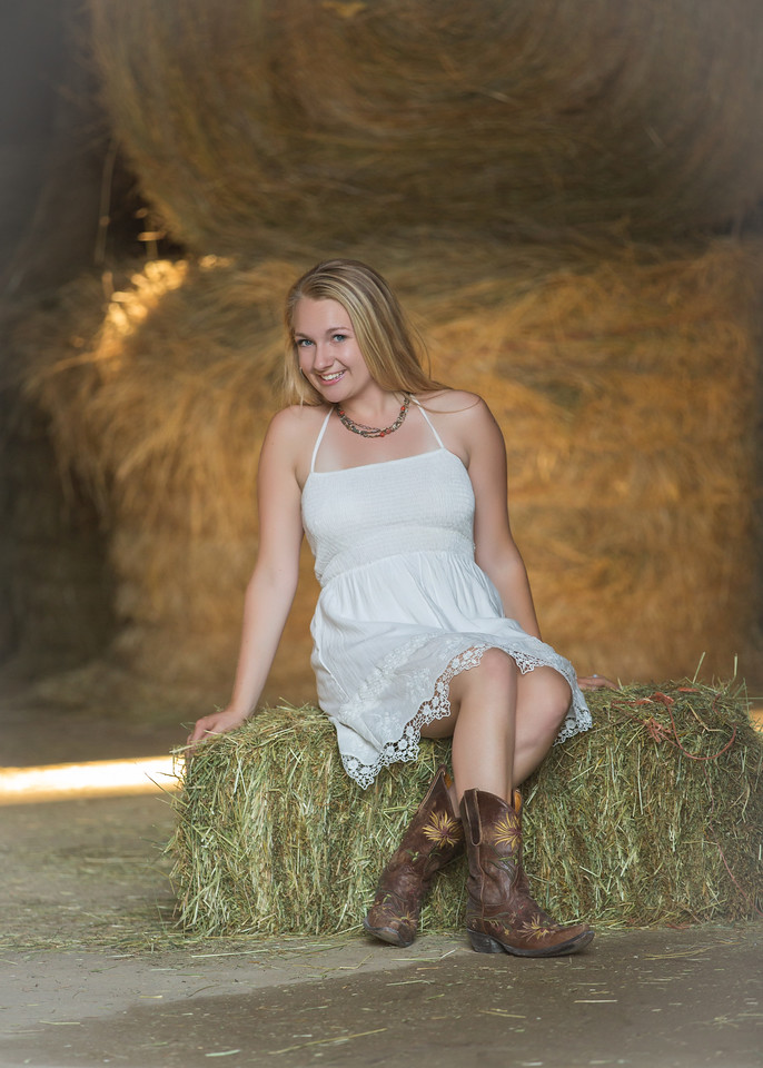sitting on the hay bails