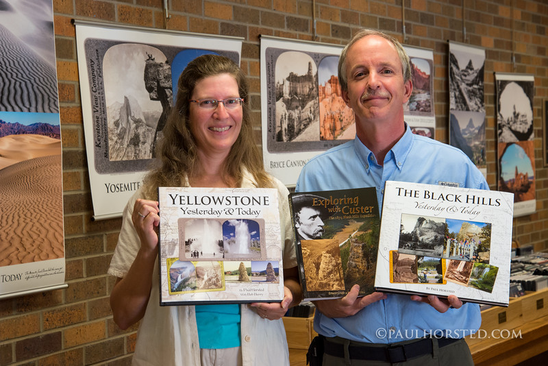 Camille Riner (book designer) and her husband, Paul Horsted, with 3 of their books.