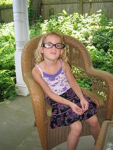 Violet wearing her mom's glasses.