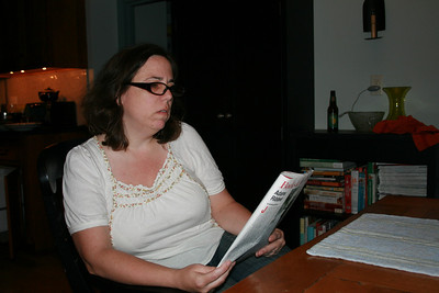 Lisa reading and fuming about Hilary Clinton.