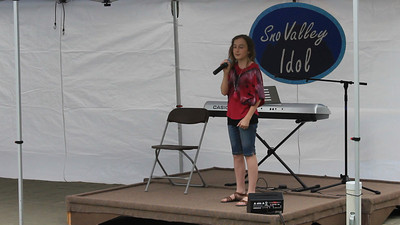 "Anastasia singing ""The House That Built Me"" by Miranda Lambert, at the North Bend Farmer's Market, June 28th, 2012."