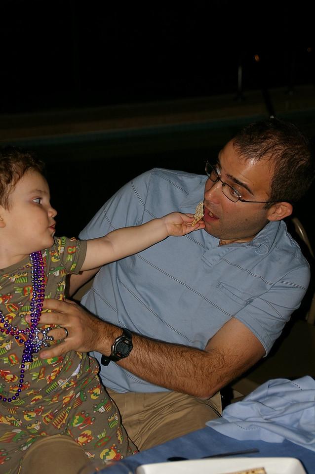 Gabe, helping daddy eat some matzah.
