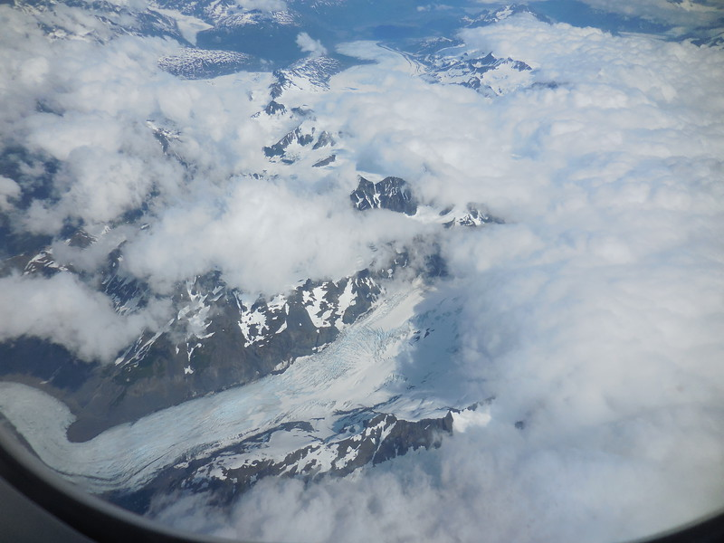 A glacier near the Alaska coastline while flying in