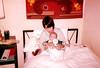 Lara sitting in bed with Kieran