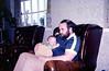Kieran sleeping on Peter's lap