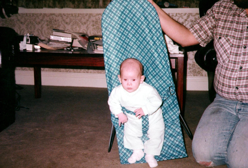 Kieran in chair with Peter