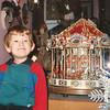 Kieran standing next to toy carousel