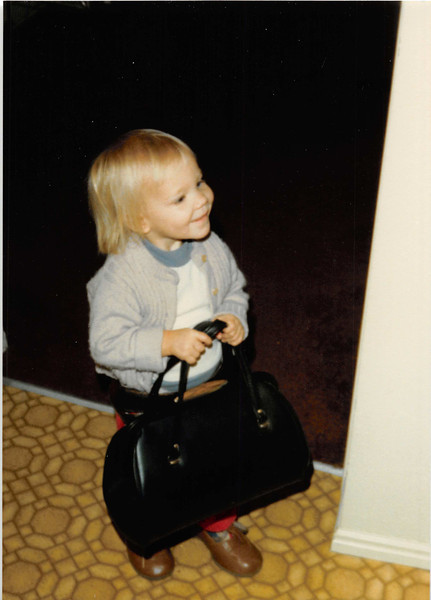 December 1980<br /> 1104 W. 680 S. Orem, UT<br /> Teresa Meakin (22 months old) carrying mom's purse and wearing mom's shoes.
