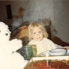 Feb. 26, 1981<br /> Phoenix, AZ<br /> Teresa admiring her birthday cake and candles.  She is 2 years old.