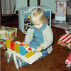 Christmas morning 1980<br /> 1104 W. 680 S. Orem, UT<br /> Teresa playing with gifts from Santa.