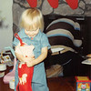 Christmas morning 1980<br /> 1104 W. 680 S. Orem, UT<br /> Teresa admiring her stocking goodies.