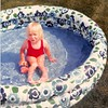 June 1981<br /> 1484 S. 400 E., Orem, UT<br /> Teresa enjoying the cool water on a hot day.