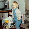 Christmas morning 1980<br /> 1104 W. 680 S. Orem, UT<br /> Teresa showing her mini hot cycle from grandparents Meakin.