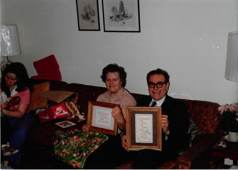December 1980<br /> 1104 W. 680 S. Orem, UT<br /> Mommy & daddy Richardson showing pictures we made (stitched) them for Christmas.