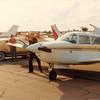 Feb. 26, 1981<br /> Phoenix, AZ<br /> Dad M. working on plane.  Grandpa F. in background.