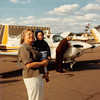 Feb. 26, 1981<br /> Phoenix, AZ<br /> Mom M., Teresa and dad M. working on plane.