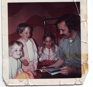 Mom thinks this is Aunt Amy's bedroom in Spokane. (How could anyone not remember that paint!) Dad says he is 28. I think Dad is reading us a National Geographic!  Joel, you are too cute! We all are!