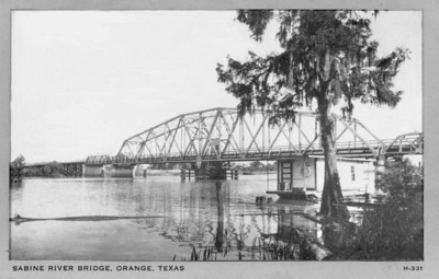 "Vintage photo of the old Sabine River Bridge on Hwy 90.  The Sabine River is the border between Texas and Louisiana.   ""The original Sabine Memorial Bridge was dedicated on June 27, 1927. It was the primary method of crossing the river (to Louisiana)  until the IH10 bridge was opened in the 1950's; it was dismantled several years later. For several years the IH10 river bridge and its approaches on each side of the bridge represented the only section of IH10 in the area.""  Above quote is from : http://www.texasfreeway.com/Other/Louisiana/Historic/abandoned/US90/US90LA.html  For more information on the bridge and the old Hwy 90 route , click on the following link:  http://www.texasfreeway.com/Other/Louisiana/Historic/abandoned/US90/US90LA-OldUS90-SabineBridge.html"