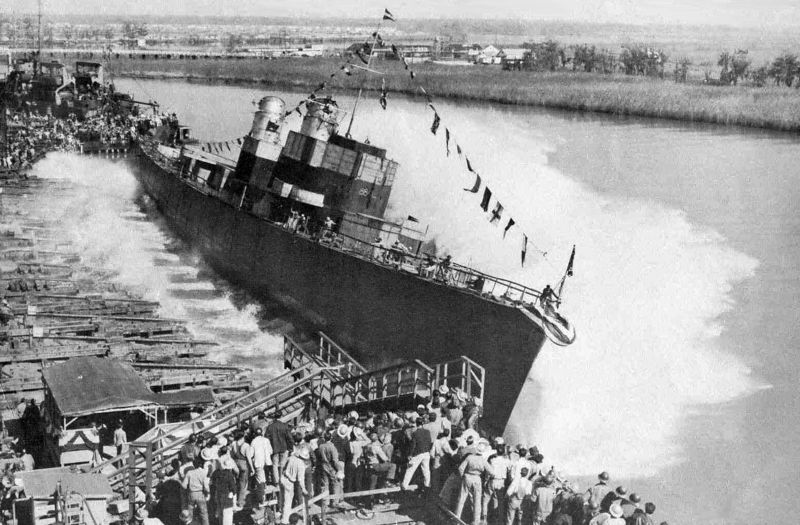 "Side launch of a ship built in Orange Texas<br /> <br /> In addition to being a Naval Base, Orange, TX was a ship building center during World War Two.  Many people , including Charles and Nedra Austin moved there to seek jobs.<br /> <br /> To read more about shipbuilding in Orange TX and the history of Orange, click on one of the following links:<br /> <br />  <a href=""http://www.globalsecurity.org/military/facility/orange.htm"">http://www.globalsecurity.org/military/facility/orange.htm</a><br /> <br />  <a href=""http://www.tsha.utexas.edu/handbook/online/articles/OO/heo1.html"">http://www.tsha.utexas.edu/handbook/online/articles/OO/heo1.html</a><br /> <br />  <a href=""http://www.texasescapes.com/TexasGulfCoastTowns/OrangeTexas.htm"">http://www.texasescapes.com/TexasGulfCoastTowns/OrangeTexas.htm</a>"