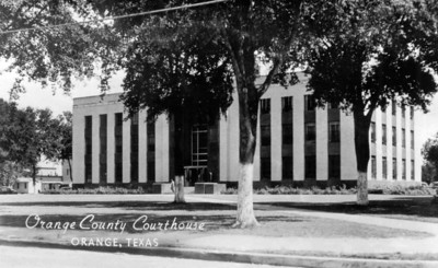 This courthouse was built in 1939, on the back of the postcard, Nedra Austin had written that the older courthouse that still stood behind it (which is no longer there) was much prettier.   You can read more about the Orange County Courthouse at:   http://www.texasescapes.com/TexasGulfCoastTowns/Orange-County-Courthouse-Texas.htm  Or click on the following link to see my 2005 photos of the courthouse:  http://jeneanne.smugmug.com/gallery/747817