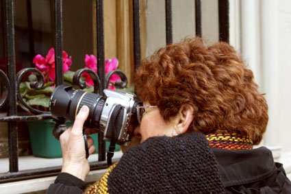 Hillary taking a picture in Buenos Aires, Argentina. July 2007. Photo taken by Daniela Scheimberg