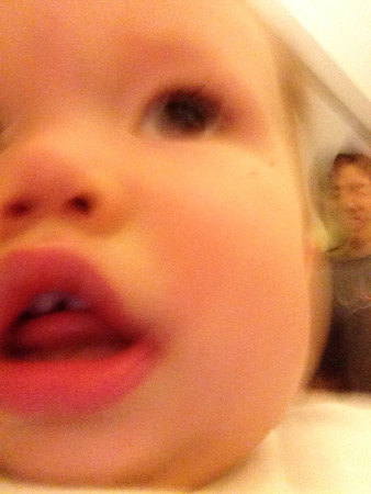 Hal is running away with daddy's phone. Daddy is chasing Hal. Photo by Hal. iPhone 5 (front), camera awesome, big button mode.