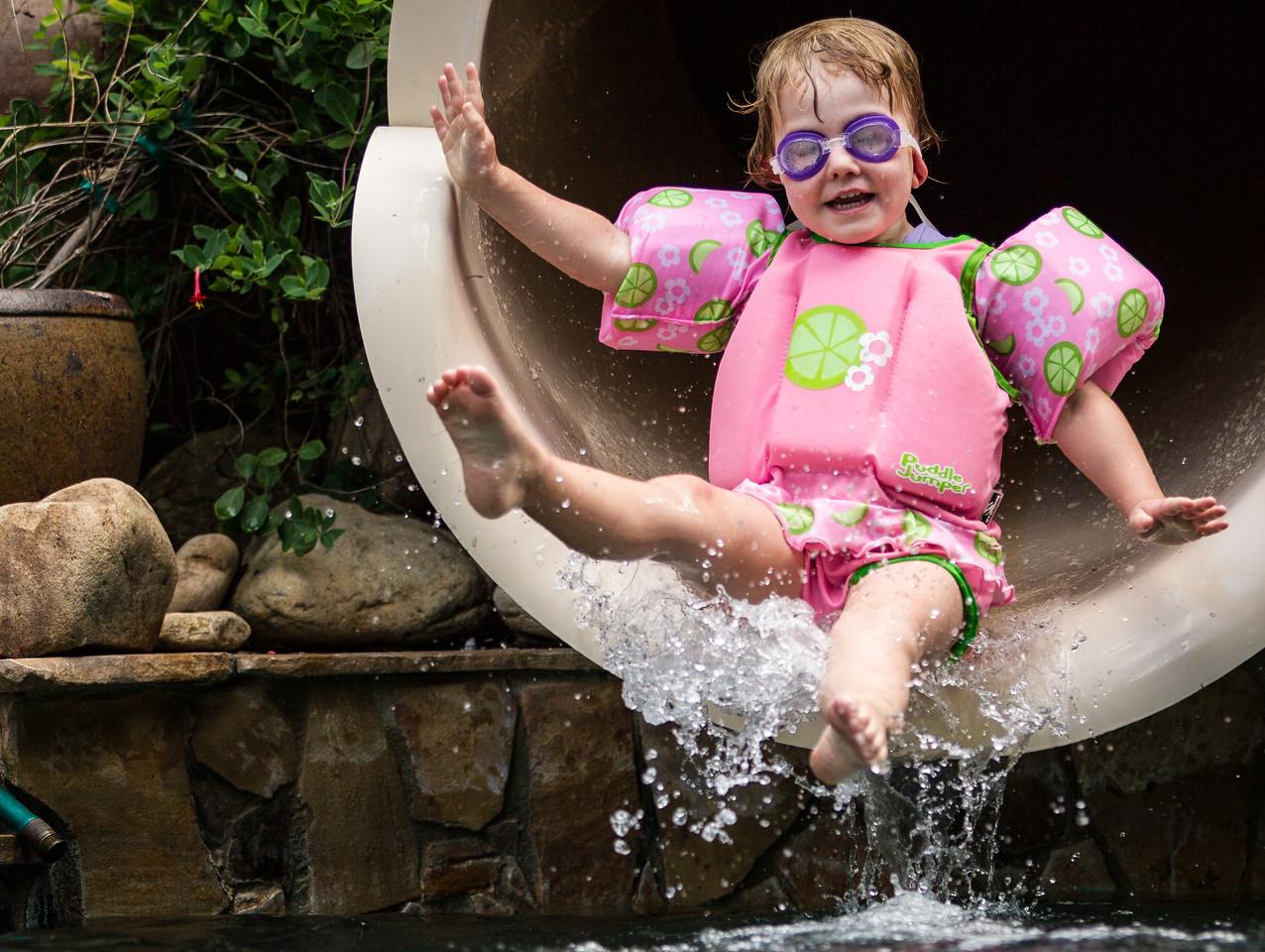 Evie slides  at the Ever After Estate