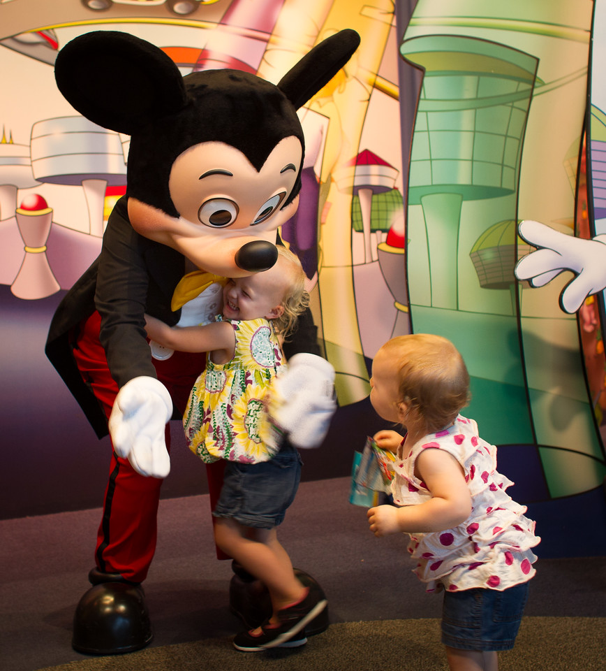 Zoe and Penny with Mickey Mouse at Disneyworld