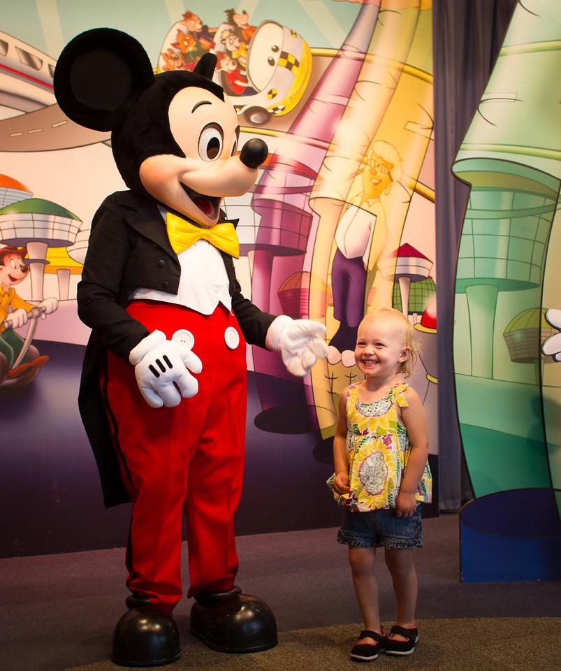 Zoe with Mickey Mouse at Disneyworld