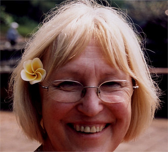 Wendy at the mausoleum of Tu Duc on the Perfumed River.  She found the flower on the ground under the tree it had fallen from, and thought it would be funny to put it in her hair.  She called me to turn round and I snapped this shot.  I don't believe she was ever conscious of her own beauty.