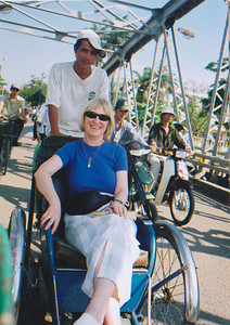 On a rickshaw at Hue, crossing the bridge over the Perfumed River (the one that was destroyed by the NVA during the 1968 Tet offensive).