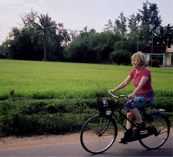 Wendy cycling back to Hoi An from the beach where we met Su