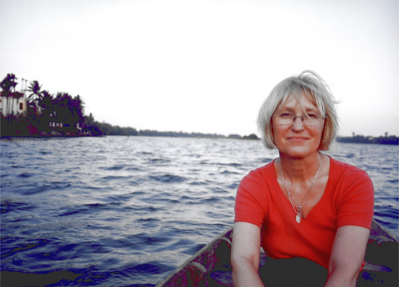 """On Em's boat on the river at Hoi An, Vietnam as she rowed us through the sunset.  Em sang a song called """"Flower For a Teacher"""" and in return I sang """"Wild Mountain Thyme"""" and """"Who Knows Where the Time Goes"""".  Sounds corny now, but beautiful at the time."""
