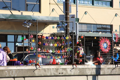 Glass artists selling their wares at Pike Place Market.