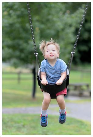 Tyler loves to swing.