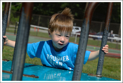 Tyler pushing the merry-go-round.